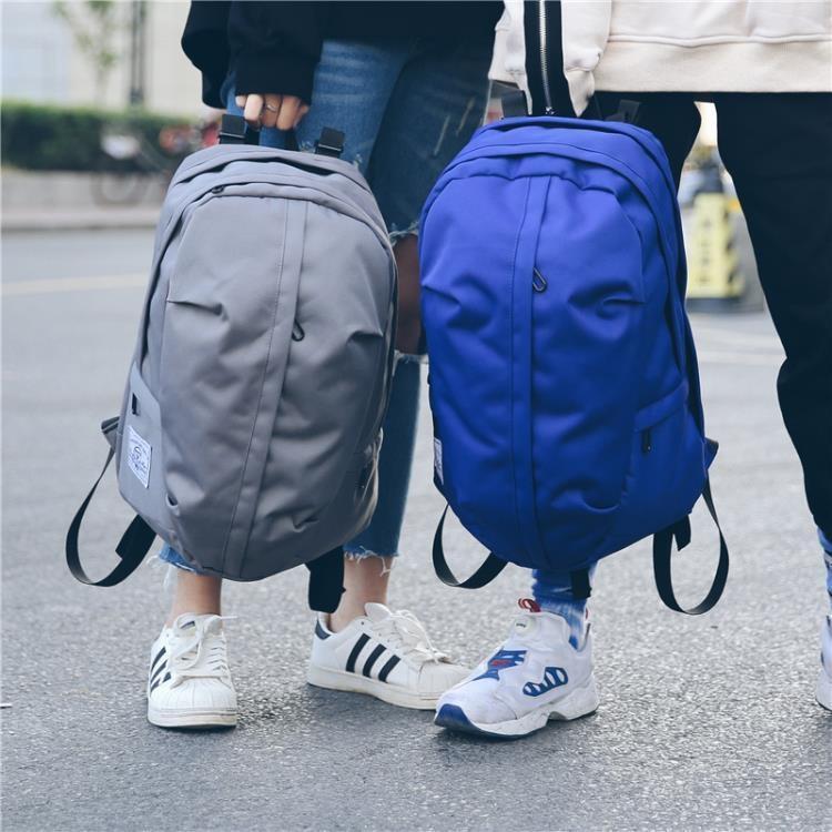 雙肩包男休閒帆布背包簡約百搭學生書包