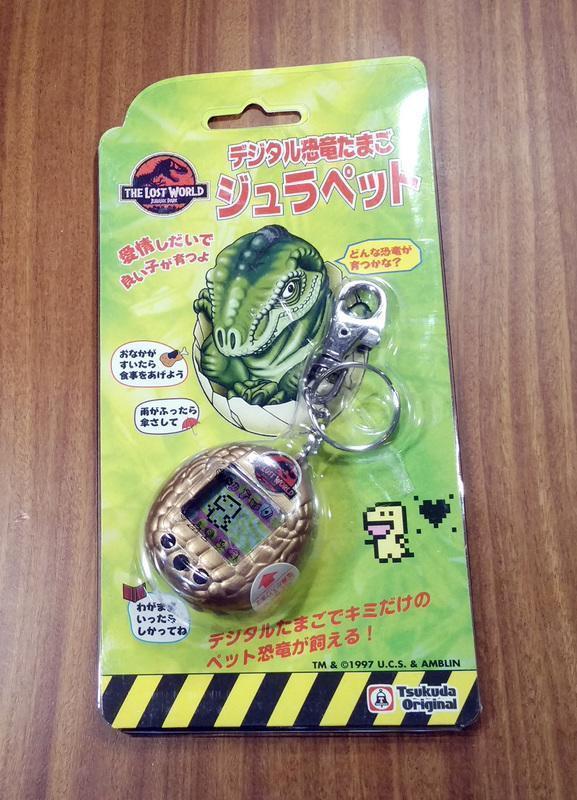 日版電玩週邊- 電子寵物 養育恐龍 金色 侏羅紀公園 (電子雞)(7-11取貨付款)